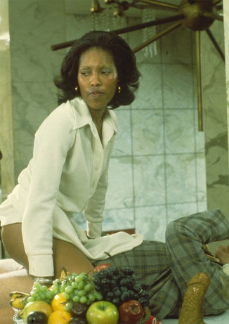Shirley Peters, 1976, on the set of Barbara Broadcast, straddling Alan Marlow.