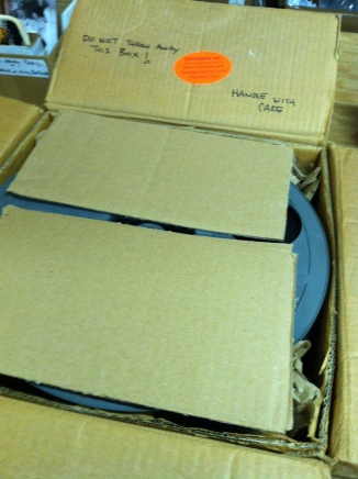 STEP 3. Film elements stacked and box covered with Cardboard scraps for extra padding and support.