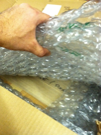 STEP 7:  Complete the packing of the OUTER BOX, use extra bubble wrap for top padding. and close with heavy duty tape.